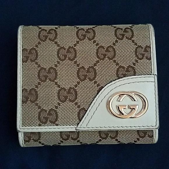 6ebb7bd6928 Gucci Handbags - Gucci Beige Ivory GG CanvasBritt Compact Wallet